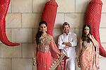 8 October 2013, New Delhi, India. Recently retired Australian cricket star Brett Lee poses with models at The Lodhi Hotel in New Delhi. He is in India to show off his latest fashion lines and to foster greater interest in Australian - Indian business interactions.  Picture by Graham Crouch