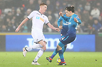 Sam Clucas of Swansea is challenged by Hector Bellerin of Arsenal during the Premier League match between Swansea City and Arsenal at the Liberty Stadium, Swansea, Wales, UK. Tuesday 30 January 2018
