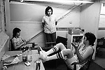 """Paul and Linda McCartney Wings Tour 1975.  Paul in discussion in rehearsal dressing room with Wings band members, Jimmy McCulloch and drummer Joe English. Elstree,  London England. The photographs from this set were taken in 1975. I was on tour with them for a children's """"Fact Book"""". This book was called, The Facts about a Pop Group Featuring Wings. Introduced by Paul McCartney, published by G.Whizzard. They had recently recorded albums, Wildlife, Red Rose Speedway, Band on the Run and Venus and Mars. I believe it was the English leg of Wings Over the World tour. But as I recall they were promoting,  Band on the Run and Venus and Mars in particular."""