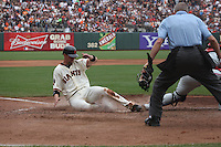 SAN FRANCISCO, CA - AUGUST 7:  Chris Stewart of the San Francisco Giants slides home safely against the Philadelphia Phillies during the game at AT&T Park on August 7, 2011 in San Francisco, California. Photo by Brad Mangin