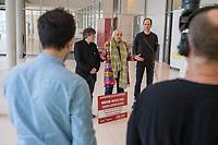 """Die Rockband """"Die Toten Hosen"""" und die Menschenrechtsorganisation """"Pro Asyl"""" haben gemeinsam ueber 41.000 Unterschriften gesammelt, um ein Zeichen fuer einen besseren Schutz von Gefluechteten und gegen Rassismus und Rechtspopulismus zu setzen. Bei einem Pressegespraech am Mittwoch den 20. Maerz 2019 uebergaben Guenter Burkhardt<br /> Geschaeftsfuehrer und Mitgruender von """"Pro Asyl"""" (links im Bild) und Michael """"Breiti"""" Breitkopf, Gitarrist der Rockband """"Die Toten Hosen"""" (rechts im Bild) die gesammelten Unterschriften an die Vizepraesidentin des Deutschen Bundestages, Claudia Roth (Buendnis 90/Die Gruenen) (mitte).<br /> 20.3.2019, Berlin<br /> Copyright: Christian-Ditsch.de<br /> [Inhaltsveraendernde Manipulation des Fotos nur nach ausdruecklicher Genehmigung des Fotografen. Vereinbarungen ueber Abtretung von Persoenlichkeitsrechten/Model Release der abgebildeten Person/Personen liegen nicht vor. NO MODEL RELEASE! Nur fuer Redaktionelle Zwecke. Don't publish without copyright Christian-Ditsch.de, Veroeffentlichung nur mit Fotografennennung, sowie gegen Honorar, MwSt. und Beleg. Konto: I N G - D i B a, IBAN DE58500105175400192269, BIC INGDDEFFXXX, Kontakt: post@christian-ditsch.de<br /> Bei der Bearbeitung der Dateiinformationen darf die Urheberkennzeichnung in den EXIF- und  IPTC-Daten nicht entfernt werden, diese sind in digitalen Medien nach §95c UrhG rechtlich geschuetzt. Der Urhebervermerk wird gemaess §13 UrhG verlangt.]"""