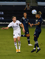 KANSAS CITY, KS - OCTOBER 07: #14 Djordje Mihailovic of Chicago Fire FC and #13 Amadou Dia of Sporting Kansas City jump up to head the ball during a game between Chicago Fire and Sporting Kansas City at Children's Mercy Park on October 07, 2020 in Kansas City, Kansas.