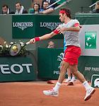 Roger Federer (SUI), defeats Diego Sebastian Schwartzman, 6-3, 6-4, 6-4 at  Roland Garros being played at Stade Roland Garros in Paris, France on May 28, 2014