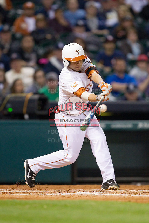 CJ Hinojosa #9 of the Texas Longhorns makes contact with the baseball against the Rice Owls at Minute Maid Park on February 28, 2014 in Houston, Texas.  The Longhorns defeated the Owls 2-0.  (Brian Westerholt/Four Seam Images)