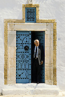 Tunisia, Sidi Bou Said.  Man and Door.  Blue and White are the Traditional Colors of Houses in Sidi Bou Said.