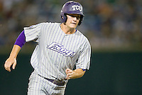 TCU's Jason Coats scores in Game 6 of the NCAA Division One Men's College World Series on Monday June 21st, 2010 at Johnny Rosenblatt Stadium in Omaha, Nebraska.  (Photo by Andrew Woolley / Four Seam Images)