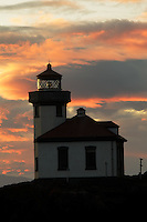 Lime Kiln Point Lighthouse silohuetted against sunset, Lime Kiln Point State Park, San Juan Island, Washington, USA