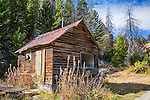 Old dilapidated buildings stand in the ghost town of Granite, Montana.