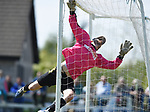 Rob Shier of Newmarket Celtic A dives into the net during their Clare Cup Final win over over Bridge United A at Frank Healy Park. Photograph by John Kelly.
