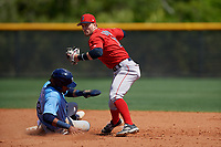 Boston Red Sox shortstop Andre Colon (11) throws to first base on a double play attempt as Diego Infante (98) slides in during a Minor League Spring Training game against the Tampa Bay Rays on March 25, 2019 at the Charlotte County Sports Complex in Port Charlotte, Florida.  (Mike Janes/Four Seam Images)