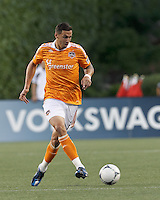 Houston Dynamo midfielder Geoff Cameron (20) passes the ball. In a Major League Soccer (MLS) match, the New England Revolution tied Houston Dynamo, 2-2, at Gillette Stadium on May 19, 2012.