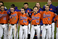 Members of the Clemson Tigers sing the alma mater after a 2-0 win against the Stony Brook Seawolves on Friday, February 21, 2020, at Doug Kingsmore Stadium in Clemson, South Carolina. (Tom Priddy/Four Seam Images)