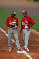 Palm Beach Cardinals hitting coach Ramon Ortiz (35) talks with base runner C.J. McElroy (3) during a game against the Lakeland Flying Tigers on April 13, 2015 at Joker Marchant Stadium in Lakeland, Florida.  Palm Beach defeated Lakeland 4-0.  (Mike Janes/Four Seam Images)