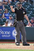 Home plate umpire Brian Hertzog call a strike during the game between Las Vegas 51s and the Omaha Storm Chasers at Werner Park on August 17, 2014 in Omaha, Nebraska. The Storm Chasers  won 4-0.   (Dennis Hubbard/Four Seam Images)