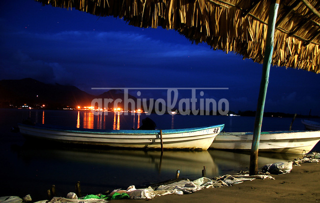 Boats are seen on the shore of Bocas del Cielo, Chiapas, Mexico on May 27, 2006..Born in Argentina, photographer Ivan Pisarenko in 2005  decided to ride his motorcycle across the American continent. While traveling Ivan is gathering an exceptional photographic document on the more diverse corners of the region. Archivolatino will publish several stories by this talented young photographer..Closer look at  Ivan's page www.americaendosruedas.com...