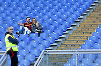 Calcio, Serie A: Roma vs Lazio. Roma, stadio Olimpico, 8 novembre 2015.<br /> Roma fans sit past a steward, in the Roma fans' curva Sud sector almost empty, due to a protest against security measurements, prior to the start of the Italian Serie A football match between Roma and Lazio at Rome's Olympic stadium, 8 November 2015.<br /> UPDATE IMAGES PRESS/Riccardo De Luca