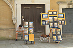 Artist and street vendor using smart phone, Venice, Italy, Europe. .  John offers private photo tours in Denver, Boulder and throughout Colorado, USA.  Year-round. .  John offers private photo tours in Denver, Boulder and throughout Colorado. Year-round.