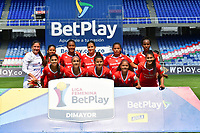 CALI – COLOMBIA, 02-11-2020: Jugadoras del América posan para una foto previo al partido por la Fecha 3 de la Liga Femenina BetPlay DIMAYOR 2020 entre América de Cali y Atlético Junior jugado en el estadio Pascual Guerrero de la ciudad de Cali. / Players of America pose to a photo prior match for the date 3 as part of Women's BetPlay DIMAYOR League 2020 between America de Cali and Atletico Junior played at Pascual Guerrero stadium in Cali. Photos: VizzorImage / Nelson Rios / Cont /