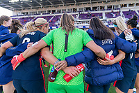ORLANDO, FL - FEBRUARY 21: Alyssa Naeher #1 of the USWNT stands with her teammates after a game between Brazil and USWNT at Exploria Stadium on February 21, 2021 in Orlando, Florida.