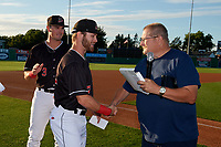 Batavia Muckdogs J.D. Orr (22) shakes hands with Booster Club President Hal Mitchell during a pre-game awards ceremony before a NY-Penn League game against the Auburn Doubledays on August 31, 2019 at Dwyer Stadium in Batavia, New York.  Auburn defeated Batavia 12-5.  Nic Ready (3) looks on.  (Mike Janes/Four Seam Images)