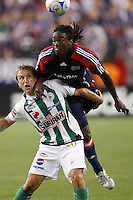 New England Revolution midfielder Shalrie Joseph (21) and Santos Laguna forward Vicente Matias Vuoso (30). The New England Revolution defeated Santos Laguna 1-0 during a Group B match of the 2008 North American SuperLiga at Gillette Stadium in Foxborough, Massachusetts, on July 13, 2008.