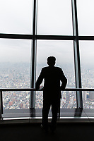 A man looks out from the viewing platform at the Tokyo Sky Tree.