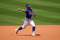 New York Mets shortstop Francisco Lindor (12) throws to first base during a Major League Spring Training game against the St. Louis Cardinals on March 19, 2021 at Clover Park in St. Lucie, Florida.  (Mike Janes/Four Seam Images)