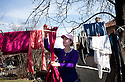 Oryahovitsa, Bulgaria, Kalaidzhi--Anni Petkova, 20, taking laundry off the line at her parents' house, is ready to marry according to the tradition of the Kalaidzhi. She participated in the annual bride market but has not yet found a fiance.