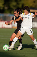 Brandi Chastain (left) chases down Aya Miyama (8) for the ball. FC Gold Pride tied the Los Angeles Sol 0-0 at Buck Shaw Stadium in Santa Clara, California on July 23, 2009.