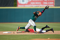 Rodolfo Castro (7) of the Greensboro Grasshoppers reaches for a wide throw as Miguel Aparicio (5) of the Hickory Crawdads steals second base at L.P. Frans Stadium on May 26, 2019 in Hickory, North Carolina. The Crawdads defeated the Grasshoppers 10-8. (Brian Westerholt/Four Seam Images)
