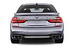 Straight rear view of a 2018 BMW 7 Series M760 Li 4 Door Sedan stock images