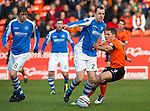 Dundee Utd v St Johnstone..26.12.12      SPL.Dave Mackay holds off John Rankin.Picture by Graeme Hart..Copyright Perthshire Picture Agency.Tel: 01738 623350  Mobile: 07990 594431