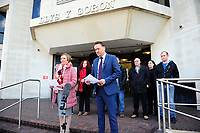 Pictured: DCI Darren George (right) of South Wales police reads a statement on behalf of the family of John 'Jack' Williams, outside Swansea Crown Court, in Wales, UK. Thursday 01 November 2018<br /> Re: Jonathan Donne, a convicted killer who murdered 67 year old John 'Jack' Williams after robbing him in his own home has been jailed for life by Swansea Crown Court.<br /> Donne, 42, from Swansea, was found guilty of the robbery and murder.<br /> Mr Williams was tied up and battered in the living room of his Swansea home in March 2018 because Donne thought he had a large quantity of drugs and money.<br /> He was told he must serve at least 31 years before he can be released from prison.<br /> He was also given a 15 year sentence for robbery, which will be served concurrently.<br /> Donne went to Mr Williams's house because he needed money where he hit and tied Mr Williams up, but insisted he was alive when he left.<br /> Mr Williams suffered serious brain and head injuries in the attack.<br /> The victim had been growing and selling cannabis and Donne thought he would have drugs and cash he could steal.
