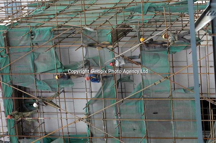 Construction worker in Beijing, China.