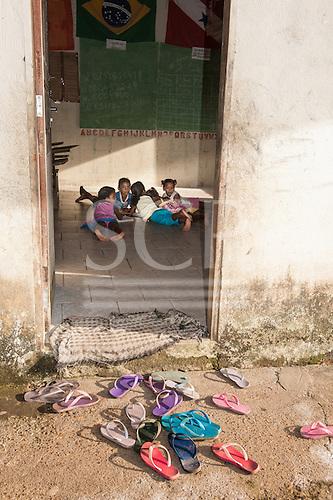 Amazon. School room and flip-flops in an Arara Indian village.
