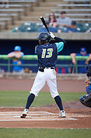 Angel Martinez (13) of the Lynchburg Hillcats at bat against the Myrtle Beach Pelicans at Bank of the James Stadium on May 22, 2021 in Lynchburg, Virginia. (Brian Westerholt/Four Seam Images)