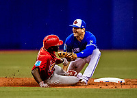 26 March 2018: Toronto Blue Jays infielder Danny Espinosa is unable to get St. Louis Cardinals outfielder Randy Arozarena out stealing second in the 5th inning at Olympic Stadium in Montreal, Quebec, Canada. The Cardinals defeated the Blue Jays 5-3 in the first of two MLB pre-season exhibition games in the former home of the Montreal Expos. Mandatory Credit: Ed Wolfstein Photo *** RAW (NEF) Image File Available ***