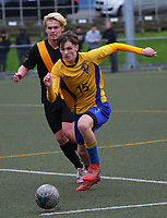 Action from the 1st XI Wellington boys youth grade football match between Wellington College and Rongotai College at Wellington College in Wellington, New Zealand on Wednesday, 30 June 2021. Photo: Dave Lintott / lintottphoto.co.nz