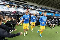 Patrick Bauer of Preston North End (L) exits the tunnel with team mates during the Sky Bet Championship match between Swansea City and Preston North End at the Liberty Stadium, Swansea, Wales, UK. Saturday 17 August 2019
