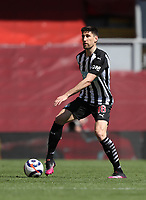 24th April 2021; Anfield, Liverpool, Merseyside, England; English Premier League Football, Liverpool versus Newcastle United; Federico Fernandez of Newcastle United looks for a team mate before passing the ball