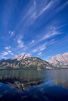 Grand Teton National Park, Wyoming, WY, USA - Grand Teton (Elev 4,197 m / 13,770 ft) and Teton Range Mountains reflecting in Jenny Lake, Summer