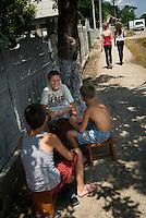 REPUBLIC OF MOLDOVA, Gagauzia, Vulcanesti, 2009/07/2..Children playing cards in the main street Tomai, and sneer at passing girls..© Bruno Cogez / Est&Ost Photography..REPUBLIQUE MOLDAVE, Gagaouzie, Vulcanesti, 2/07/2009..Des enfants jouent aux cartes dans la rue principale de Tomai, et ricanent au passage des filles..© Bruno Cogez / Est&Ost Photography