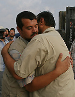 Palestinians hug their relatives after they returned from Egypt into Gaza Strip through Erez crossing 29 July 2007 in Beit Hanun, northern Gaza Strip. Around 100 of the thousands of Palestinians stranded in Egypt crossed into Israel on their way to Gaza today, but many left behind said they were barred for their political beliefs. Egypt and Israel yesterday agreed that 627 of the 6,000 stranded Palestinians, who have been living in increasingly dire conditions, would be allowed back to the Gaza Strip, with 100 crossing today and 527 tomorrow.