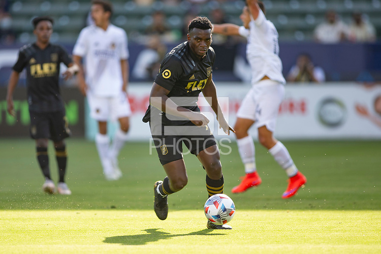 CARSON, CA - MAY 8: Jesus David Murillo #94 of LAFC moves with the ball during a game between Los Angeles FC and Los Angeles Galaxy at Dignity Health Sports Park on May 8, 2021 in Carson, California.