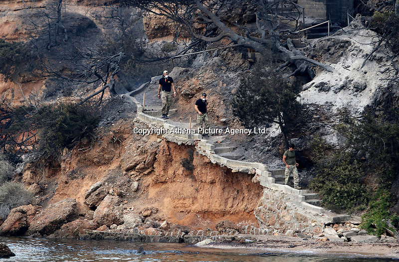 Pictured: Specialist search parties look for missing people in the sea, in the Mati area, Kokkino Limanaki near Rafina, Greece. Tuesday 24 July 2018<br /> Re: Deaths caused by wild forest fires throughout Greece.