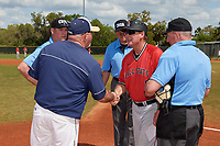 Ball State Cardinals head coach Rich Maloney (2) shakes hands with Scott Thomson during the lineup exchange with umpires Phil Pupillo, Kyle Travis, and Gary Rosplohowski before a game against the Mount St. Mary's Mountaineers on March 9, 2019 at North Charlotte Regional Park in Port Charlotte, Florida.  Ball State defeated Mount St. Mary's 12-9.  (Mike Janes/Four Seam Images)