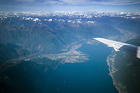 Switzerland. Canton Ticino. Aerial view from Locarno, Ascona, its surroundings and the Lake Maggiore. View from a Saab 2000 airplane of Adria Airways company. The Saab 2000 is a twin-engined high-speed turboprop airliner built by Saab. It is designed to carry 50–58 passengers and cruise at a speed of 665 km/h. Lake Maggiore (Italian: Lago Maggiore or Verbano) is a large lake located on the south side of the Alps. It is the second largest lake in Italy and the largest in southern Switzerland. The lake and its shoreline are divided between the Italian regions of Piedmont and Lombardy and the Swiss canton of Ticino. 1.06.2019 © 2019 Didier Ruef