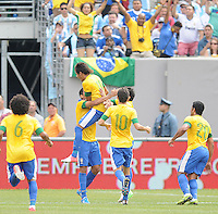 Brazil midfielder Romulo (8) celebrates his score with teammates. The Argentina National Team defeated Brazil 4-3 at MetLife Stadium, Saturday July 9 , 2012.