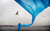 "Dilan stands on the banks of the Bosphorus wrapped in a blue cloth..Dilan Kaya is 21 years old and lives in Istanbul. Since she was a young girl she has been dreaming of being free like a bird. Dilan is studying now and in her spare time she is working to enhance the future of others. ""As long as I can remember I've dreamt of flying, to go where I want to go. As a woman, this is by not always obviously possible in my world. Now I am able to study now but I wish that every child would be able to do so.""...."