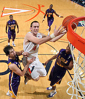 Jan. 2, 2011; Charlottesville, VA, USA; Virginia Cavaliers forward Will Regan (4) is surrounded by LSU Tigers defenders as he drives to the basket during the game at the John Paul Jones Arena. Virginia won 64-50. Mandatory Credit: Andrew Shurtleff-